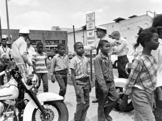 Police send a group of African American school children to jail in Birmingham, Ala. on May 4, 1963. (Bill Hudson/AP)