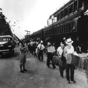 Men at train station | Zinn Education Project
