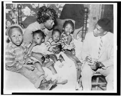 Medgar Evers is interviewing Beulah Melton about the murder of her husband, Clinton Melton in 1955. Mrs. Melton died (likely killed) before she could testify. Click photo to learn more. This is one of many murder cases Evers investigated. Photo: Library of Congress.