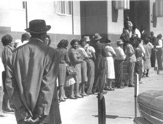 """Freedom Day"" in Selma, October 1963. Blacks line up at the courthouse to apply to register to vote. © John Kouns."