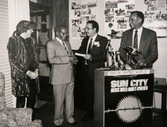 "Little Steven van Zandt, producer of ""Sun City""; Oliver R. Tambo; Tilden LeMelle, and Harry Belafonte, MC of the"