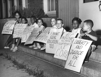 Textbooks seldom depict institutionalized racism and resistance in the North. Photo: Children picket high school in 1962 in Long Island, NY. (c) Newsday, Inc