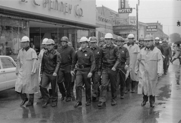 """Riot squad"" on January 22, 1964 marching down Pine Street to courthouse where citizens plan to register to vote."