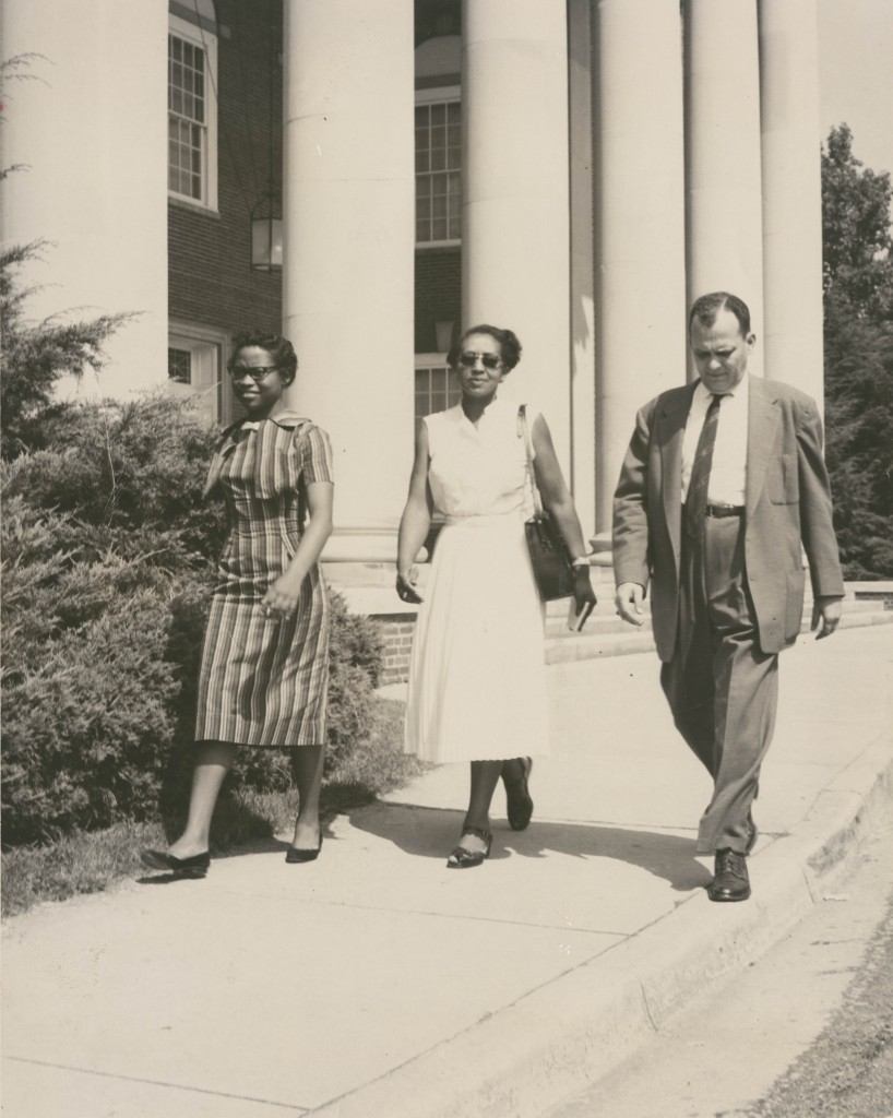 Velma Hopkins, center, became involved in the Civil Rights Movement. Here she is escorting the first black student to the newly desegregated R. J. Reynolds High School in North Carolina. Image: Digital Forsyth.