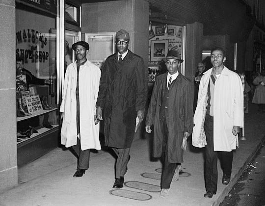 Feb. 1, 1960, Greensboro, NC: The participants after leaving the Woolworth's by a side exit. The four are (L-R): Richmond, McCain, Blair, and McNeil. (No photographers were allowed into Woolworth's during this first protest.) Image: © Corbis.