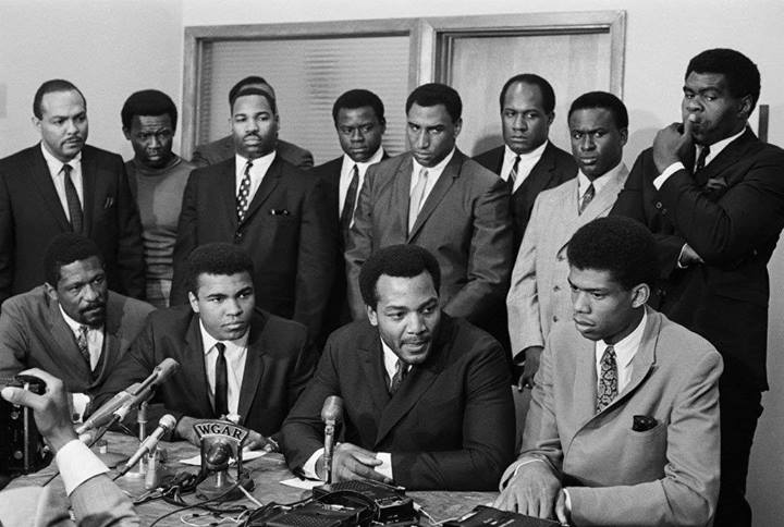 On June 4, 1967, black athletes met in Cleveland to discuss their support for Ali. How many can you recognize? Click on the image for a story about this historic meeting and names of all the attendees.