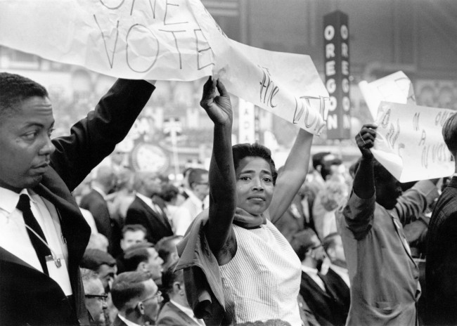 MFDP delegates demonstrate as President Lyndon Johnson is being nominated. Victoria Gray from Hattiesburg, the woman at center, is a prominent MFDP leader. George Ballis Atlantic City, New Jersey, 1964