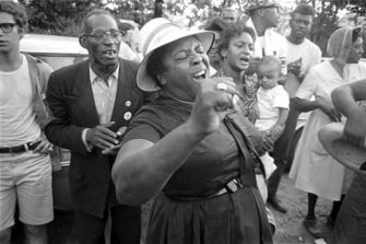 "Fannie Lou Hamer singing during the 1966 ""March Against Fear."" Image: Jim Peppler, Alabama Dept. of Archives and History."