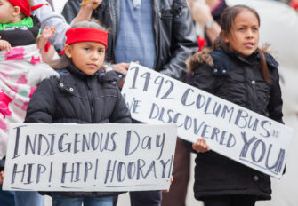 Children holding signs - Indigenous Peoples Day Parade - Seattle | Zinn Education Project: Teaching People's History