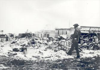Man Walking Through Debris | Zinn Education Project