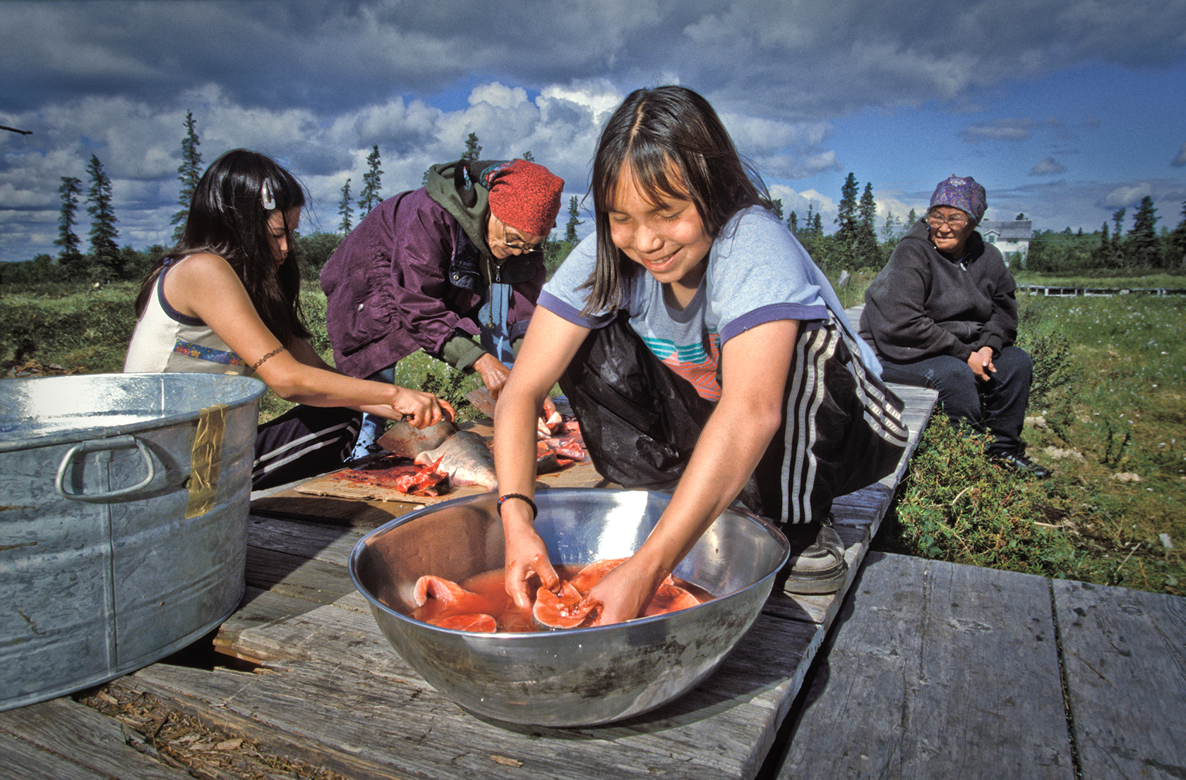Yup'ik children preparing salmon | Zinn Education Project