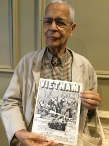 Julian Bond holding Vietnam Comic Book | Zinn Education Project