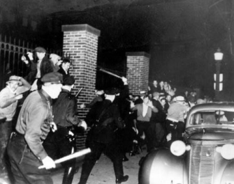 Photo of striking rubber workers clashing with police in Akron Ohio, 1936