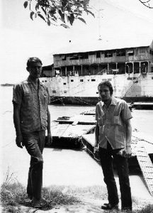 Mutineers Clyde McKay and Alvin Glatkowski outside the prison ship on the Mekong River