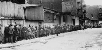 Breadline at McAuley Water Street Mission under Brooklyn Bridge, New York, circa 1930.
