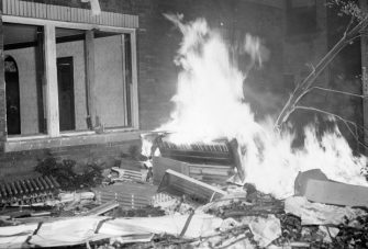 Black and white photograph of a burning piano