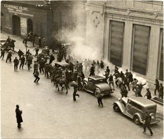 Police use tear gas against participants in San Francisco's 1934 general strike.